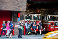 New York, New York City. People outside a Firehouse in the Theater District.