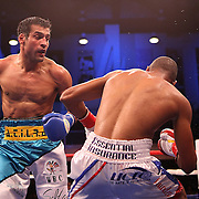 Luis Carlos Abregu (L) knocks down Thomas Dulorme for the second time in a fight for the WBC International title during the HBO Triple Explosion fight at the Turning Stone Resort Casino in Verona, NY, on Saturday, Oct 27, 2012.  Abregu won the bout by TKO in the 7th round.(AP Photo/Alex Menendez)
