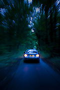BMW car on country road at night, Gloucestershire, United Kingdom