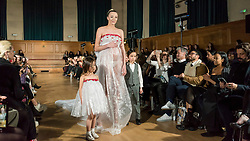 © Licensed to London News Pictures. 13/02/2020. LONDON, UK. A pregnant model wears a creation by Chanel Joan Elkayam at her AW20 showcase at Cecil Sharp House in Camden during London Fashion Week AW20.  Chanel Joan Elkayam is the youngest designer to have presented at the four major venues of London, Paris, Milan and New York.  Photo credit: Stephen Chung/LNP