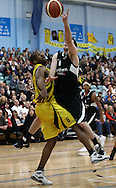 Guildford, England, Sunday 21st March 2010:  Andrew Bridge of Newcastle (6) jumps to score past Jerrah Young (5) of Cheshire during the  BBL Trophy Final between Cheshire Jets and Newcastle Eagles at the Guildford Spectrum, Surrey, UK. Final score Cheshire 95-111 Newcastle.  (photo by Andrew Tobin/SLIK images)