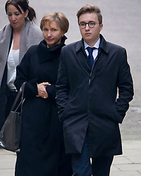 © Licensed to London News Pictures. 21/01/2016. London, UK.  Marina Litvinenko (C) and her son Anatoly arrive at The High Court. The report into the killing of  Alexander Litvinenko, who was poisoned with the radioactive isotope polonium-210 in London in 2006 is being released today.  Photo credit: Peter Macdiarmid/LNP