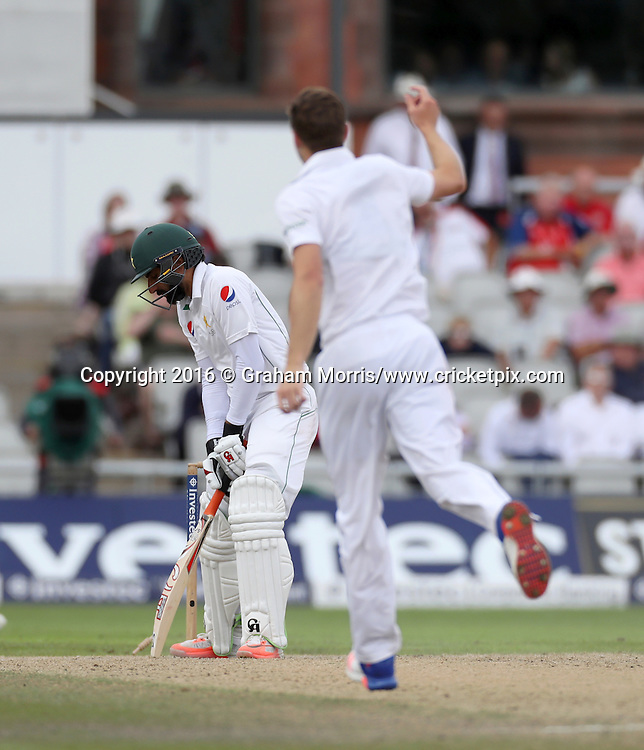 Misbah-ul-Haq is bowled by Chris Woakes during the second Investec Test Match between England and Pakistan at Old Trafford, Manchester. Photo: Graham Morris/www.cricketpix.com 25/7/16