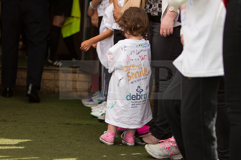 © Licensed to London News Pictures . 02/08/2015 . Droylsden Football Club , Manchester , UK . Mascot . Celebrity football match in aid of Once Upon a Smile and Debra , featuring teams of soap stars . Photo credit : Joel Goodman/LNP