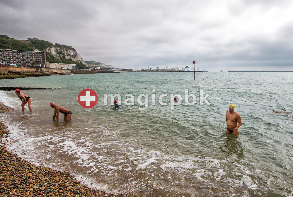 Gino Deflorian (R) of Switzerland talks to his coach during a break in a training session at the harbour in Dover, Great Britain, Saturday, Aug. 17, 2013. Gino Deflorian tries to become the first Swiss male swimmer who successfully swims the English Channel form Dover/Folkestone to Calais, France. (Photo by Patrick B. Kraemer / MAGICPBK)