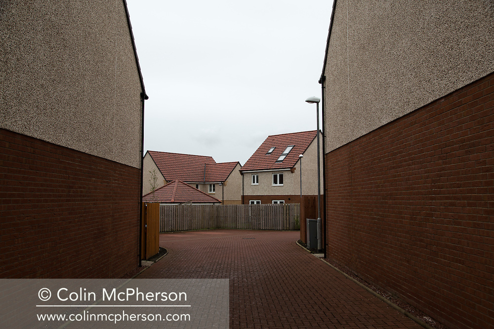 'Untitled, 2014' from the project 'The Fall and Rise of Ravenscraig' by photographer Colin McPherson.<br /> <br /> The photograph shows a housing development at the northern end of the Ravenscraig site, near Carfin.<br /> <br /> This project, photographed in 2014, looks at the topography of the post-industrial landscape at Ravenscraig, the site until its closure in 1992 of the largest hot strip steel mill in western Europe. In its current state, Ravenscraig is one of the largest derelict sites in Europe measuring over 1,125 acres (4.55 km2) in size, an area equivalent to 700 football pitches or twice the size of Monaco. It is currently being developed with a mix of housing, retail and the home of South Lanarkshire College and the Ravenscraig Regional Sports Facility.