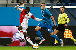 October 4, 2018 - Saint Petersburg, Russia - Artem Dzyuba (R) of FC Zenit Saint Petersburg and Michael Ngadeu-Ngadjui of SK Slavia Prague vie for the ball during the Group C match of the UEFA Europa League between FC Zenit Saint Petersburg and SK Sparta Prague at Saint Petersburg Stadium on October 4, 2018 in Saint Petersburg, Russia. (Credit Image: © Mike Kireev/NurPhoto/ZUMA Press)