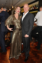 CAMILLA RUTHERFORD and DOMINIC BURNS at a dinner to celebrate 20 years of Maria Grachvogel's fashion label held at Salmontini, 1 Pont Street, London on 22nd October 2014.