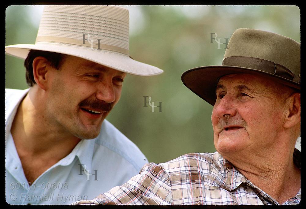 Farmer Jack Veitch (right) & Yugoslavian immigrant Zel Bodulovic swap jokes; Coolamon, NSW. Australia