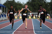 Jun 22, 2019; Miramar, FL, USA; Matthew Boling (center) wins the 100m in a wind-aided 10.15 during the USATF U20 Championships at Ansin Sports Complex. From left: Arian Smith, Boling and Justin Ofotan.