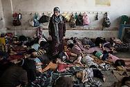 Gaza Strip, Jabalia: Displaced Palestinians from Beit Hanoun sleep inside the UNRWA school in Jabalia where they sought shelter. ALESSIO ROMENZI