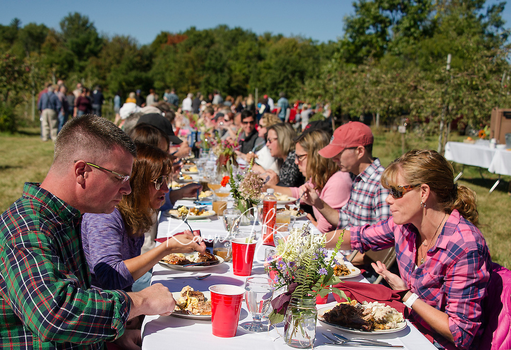 """Approximately 130 guests joined together at the table for Sunday morning's """"Breakfast in the Orchard"""" at Smith Orchard in Belmont served by Chef Halligan and his crew from Local Eatery.    (Karen Bobotas/for the Laconia Daily Sun)"""