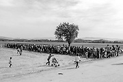 19 April 2016, Idomeni Greece - Refugees lined up for lunch delivery in the field of Idomeni.