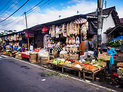07 AUGUST 2017 - BEBANDEM, BALI, INDONESIA: Part of the market in Bebandem, in far eastern Bali. The market is known for baskets, which are woven in the area. Bali's local markets are open on an every three day rotating schedule because venders travel from town to town. Before modern refrigeration and convenience stores became common place on Bali, markets were thriving community gatherings. Fewer people shop at markets now as more and more consumers go to convenience stores and more families have refrigerators.     PHOTO BY JACK KURTZ