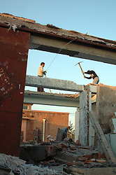 China, Beijing, Ping Fang Xiang, 2008. Slowly but surely, teams of men using little more than pickaxes and sledgehammers destroy a swath of housing to make way for new development in Ping Fang Xiang..