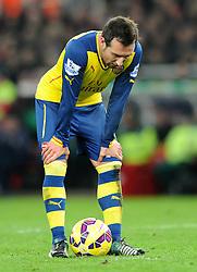 Arsenal's Santi Cazorla cuts a dejected figure - Photo mandatory by-line: Dougie Allward/JMP - Mobile: 07966 386802 - 06/12/2014 - SPORT - Football - Stoke - Britannia Stadium - Stoke City v Arsenal - Barclays Premie League