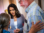 27 APRIL 2019 - STUART, IOWA: US Representative TULSI GABBARD, (D-HI) a candidate for the Democratic nomination for the US presidency, talks to individual voters after her speech at the Reaching Rural Voters Forum in Stuart. The forum was an outreach by Democrats in Iowa's 3rd Congressional District to mobilize Democratic voters statewide. Iowa saw one of the largest shifts from Democrats to Republicans in the 2016 Presidential election and Trump won the state by double digits. Republicans control the governor's office and both chambers of the Iowa legislature. Iowa traditionally hosts the the first selection event of the presidential election cycle. The Iowa Caucuses will be on Feb. 3, 2020.      PHOTO BY JACK KURTZ