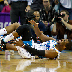 January 24,  2011; New Orleans, LA, USA; New Orleans Hornets point guard Chris Paul (3) reacts after twisting his left ankle during the final minute of a win over the Oklahoma City Thunder at the New Orleans Arena. The Hornets defeated the Thunder 91-89. Mandatory Credit: Derick E. Hingle