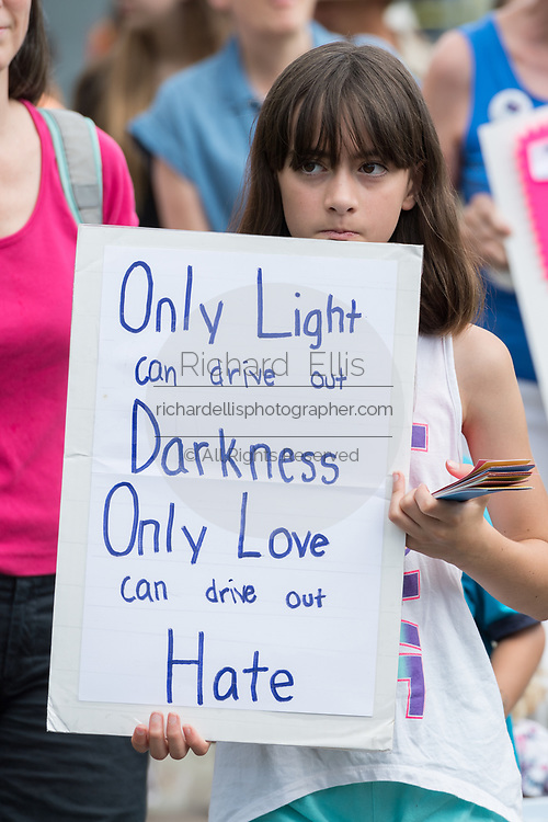 A young girl carries a poster during the Hate Won't Win Unity walk to the Mother Emanuel African Methodist Episcopal Church marking the 2nd anniversary of the mass shooting June 17, 2017 in Charleston, South Carolina. Nine members of the historic African-American church were gunned down by a white supremacist during bible study on June 17, 2015.