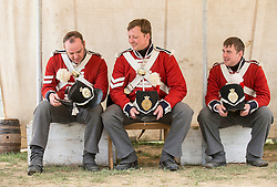 © London News Pictures. 17/06/2015. BELGIUM. <br /> Re-enactors, posing as Coldstream Guards in the same uniforms as the soldiers would have been wearing 200 years ago.. 200 years since the eve of the Battle of Waterloo, Their Royal Highnesses The Prince of Wales and the Duchess of Cornwall attended a special ceremony at Hougoumont Farm, the Belgian Farm Wellington claimed was instrumental in his victory.  Photo credit: Sergeant Rupert Frere/LNP