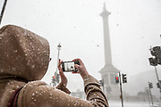 UNITED KINGDOM, London: 27 February 2018 Visitors and Londoners get caught out in the heavy snow fall at Trafalgar Square in the heart of London this afternoon.<br /> Rick Findler  / Story Picture Agency
