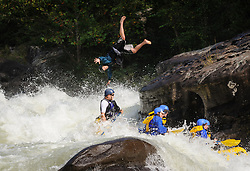 An unidentified whitewater kayaker jumps into the Gauley River rapids at Pillow Rock during American Whitewater's Gauley Fest weekend as unidentified rafters pass by. The upper Gauley, located in the Gauley River National Recreation Area is considered one of premier whitewater rivers in the country.