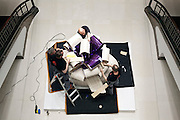 Jeff Koons sculpture Smooth Egg with Bow (Magenta-Violet) being wrapped up after being sold at Christie's New York Rockefeller Plaza Post-war and Contemporary art sale 10 may 2016