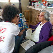 NOVEMBER 17, 2017&ndash;MARICAO, PUERTO RICO&mdash;<br /> Mercy Corps staffers Karla Pe&ntilde;a and Pardis Barjesteh deliver and demonstrate a water filtration system to Felicita Dragones inside her Hurricane Maria damaged house in the mountain town of Maricao. Dragones lives alone in the house which lost parts of its roof and is now covered with a blue tarp.<br /> (Photo by Angel Valentin)