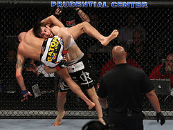 Mar 27, 2010; Newark, NJ, USA; Jon Fitch (black trunks) and Ben Saunders (white trunks) fight at UFC 111 at the Prudential Center in Newark, NJ.   won via .