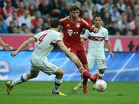 FUSSBALL   1. BUNDESLIGA  SAISON 2012/2013   2. Spieltag FC Bayern Muenchen - VfB Stuttgart      02.09.2012 William Kvist (li, VfB Stuttgart)  gegen Thomas Mueller (FC Bayern Muenchen)