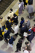 over head view of commuters waiting for train Tokyo Japan