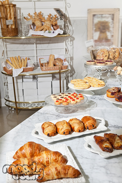 Varieties of fresh breads and sweet food at bakery