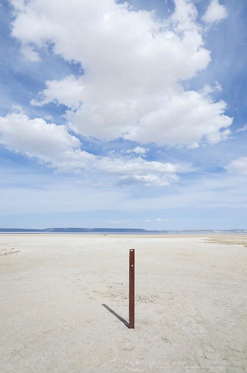 Marker on edge of dry Alvord Lake, a seasonal shallow alkali lake in Harney County, Oregon