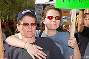 15 NOVEMBER 2008 -- PHOENIX, AZ: CHASE CRUMP (left) and her wife, ALICE CRUMP, at a gay rights protest in Phoenix Saturday. They were married in California in Ocotber 2008. About 1,500 people, gay and straight, participated in a rally at the Phoenix, AZ, city hall to protest the passage of Proposition 102 in Arizona and Proposition 8 in California on November 4. In both states the propositions essentially defined marriage as between a man and woman and banned same sex marriages. The protest in Phoenix was one of several held across the United States Saturday. Photo by Jack Kurtz / ZUMA Press