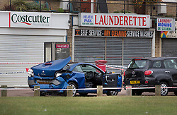 © Licensed to London News Pictures. 26/09/2016. London, UK.  Damaged vehicles believed to have been involved in a disturbace that lead to a man being fatally stabbed are seen near  Briantree Road, Dagenham. Police were called to to a disturbance in Braintree Road on Sunday evening 25th September 2016 where officers found a man in his thirties suffering from stab wounds. He died at the scene a short while later. A murder investigation has been launched. Photo credit: Peter Macdiarmid/LNP