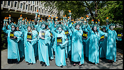 April 27, 2017 - London, London, United Kingdom - Image ©Licensed to i-Images Picture Agency. 27/04/2017. London, United Kingdom. Amnesty Protest 100 Days of Trump...One hundred human rights activists from Amnesty International dressed as the Statue of Liberty protest outside the US Embassy in London's Grosvenor Square. The protest is set to mark 100 days of Donald Trump's presidency of the United States of America... Picture by Pete Maclaine / i-Images (Credit Image: © Pete Maclaine/i-Images via ZUMA Press)