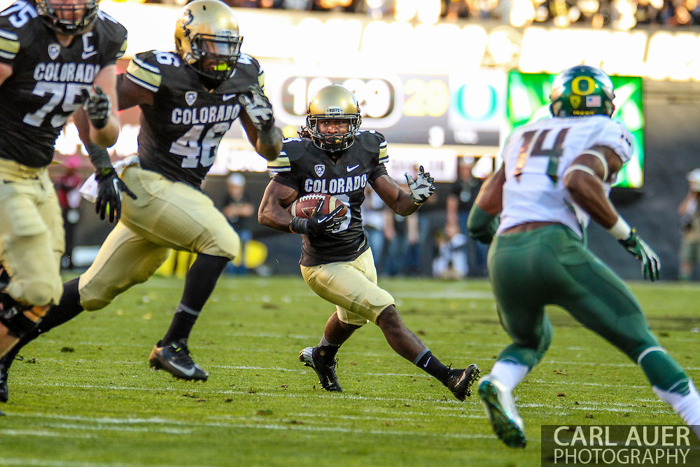 October 5th, 2013:  Colorado Buffaloes freshman wide receiver Bryce Bobo (3) runs the ball in the second quarter of the NCAA football game between the University of Oregon Ducks and the Colorado Buffaloes at Folsom Field in Boulder, Colorado