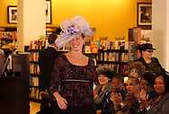 Model Jennifer Reitz of the Blaine Block Institute for Voice Analysis & Rehabilitation on the runway during the Crowns Hat Fashion Show at Books & Company in The Greene in Beavercreek, Saturday, February 23, 2013.