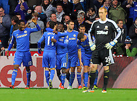 Saturday, 03 November 2012..Pictured: Victor Moses of Chelsea (C) celebrating the opening goal with team mates while Swansea goalkeeper Gerhard Tremmel (R) looks dejected...Re: Barclays Premier League, Swansea City FC v Chelsea at the Liberty Stadium, south Wales.