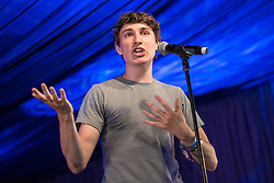 Image ©Licensed to i-Images Picture Agency. 18/07/2014  Henham Park , Suffolk, United Kingdom. Actor and comedian TOM ROSENTHAL performs on the Comedy Stage at Henham Park on what is forecast to be the hottest day of the year so far with temperatures due to hit 30 degrees centigrade. The Latitude Festival of music and arts. Picture by Joel Goodman / i-Images