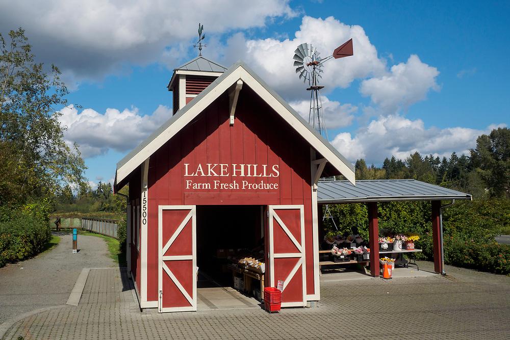 USA, Washington, Bellevue. Produce stand and barn and windmill at Lake Hills Greenbelt Park.