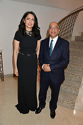 RENU MEHTA and LORD VERJEE at the Fortune Forum Club dinner in the presence of HSH Prince Albert II of Monaco held at The Dorchester, Park Lane, London on 15th January 2014.