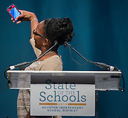 Kaleigh Davis of the Energy Institute High School takes a photo from the stage during the Houston ISD State of the Schools luncheon at the Hilton of the Americas, February 26, 2014.
