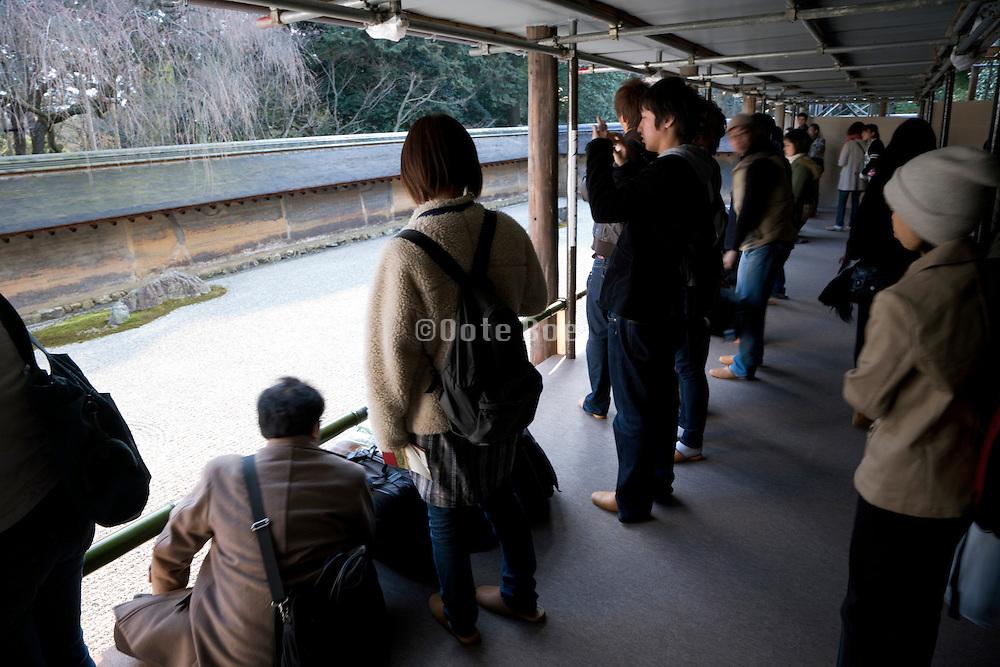 mass tourism at the Ryoanji Temple zen garden in Kyoto