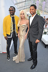 Left to right, WILL.I.AM, DONATELLA VERSACE and CUBA GOODING Jr at the Glamour Women of the Year Awards 2012 in association with Pandora held in Berkeley Square Gardens, London W1 on 29th May 2012.