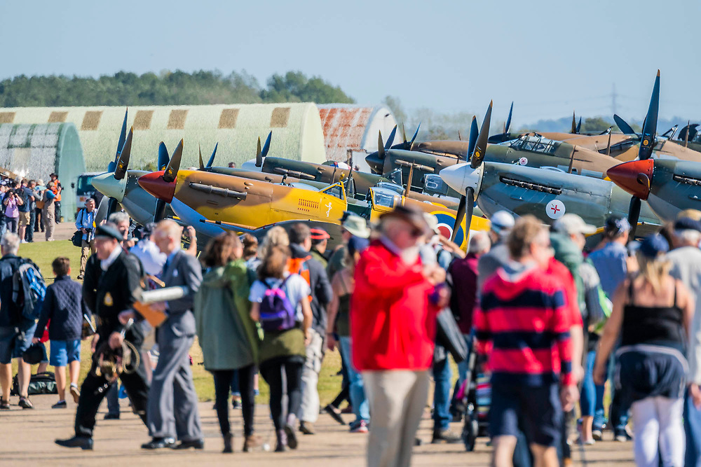 Crowds passing the Spitfires and Hurricanes on the flight line - Duxford Battle of Britain Air Show at the Imperial War Museum. Also commemorating the 50th anniversary of the 1969 Battle of Britain film. It runs on Saturday 21 & Sunday 22 September 2019