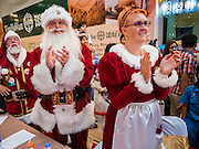 17 SEPTEMBER 2015 - BANGKOK, THAILAND: JAKOB GISLUND and his wife, ANNE GISLUND, as Mr and Mrs Santa Claus, applaud at the end of the pageant at the World Santa Claus Congress in Bangkok.  Twenty-six Santa Clauses from around the world are in Bangkok for the first World Santa Claus Congress. The World Santa Claus Congress has been an annual event in Denmark since 1957. This year's event, hosted by Snow Town, a theme park with a winter and snow theme, hosted the event. There were Santas from Japan, Hong Kong, the US, Canada, Germany, France and Denmark. They presented gifts to Thai children and judged a Santa pageant. Thailand, a Buddhist country, does not celebrate the religious aspects of Christmas, but Thais do celebrate the commercial aspects of the holiday.    PHOTO BY JACK KURTZ