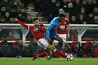 Matty Cash slides in to make a good challenge for Forest  during The Emirates FA Cup Third Round match between Nottingham Forest and Arsenal at City Ground on January 7, 2018 in Nottingham, England.