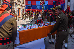 April 3, 2017 - Srinagar, Jammu and Kashmir, India - Indian policemen adjust the coffin containing the body of their  comrade  killed in a grenade attack by suspected militants, during a wreath laying ceremony on April 03, 2017 in Srinagar, the summer capital of Indian administered Kashmir, India. A wreath laying ceremony was held today for an Indian policeman who was killed and 14 others wounded when suspected militants lobbed a hand grenade yesterday evening on their patrolling party in the Nowhatta area of Srinagar. (Photo by Yawar Nazir/NurPhoto) (Credit Image: © Yawar Nazir/NurPhoto via ZUMA Press)
