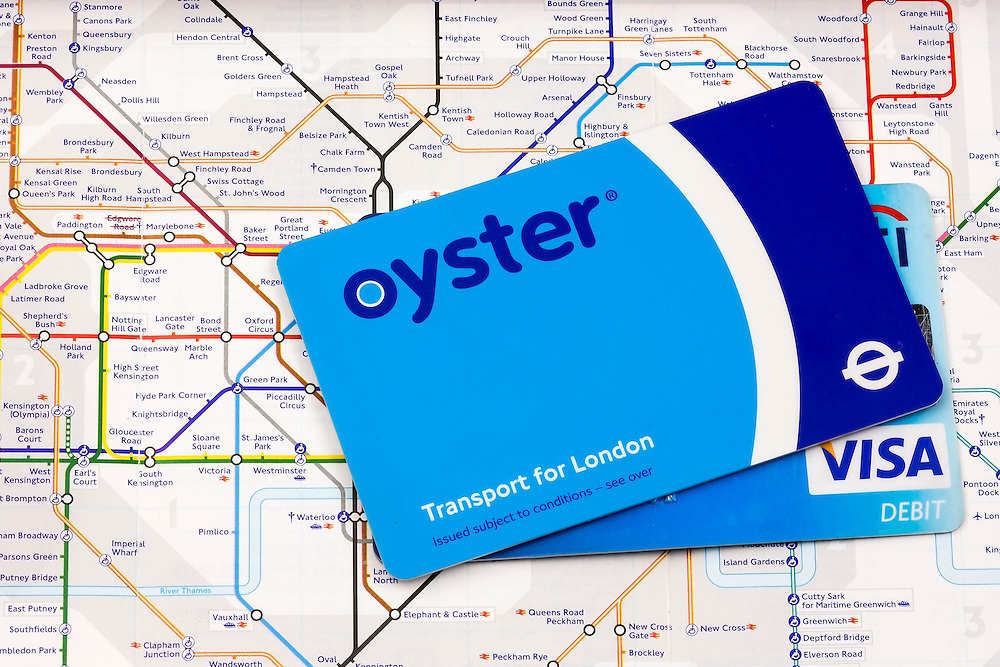 The Oyster card is a credit card sized electronic payment system used on public transport throughout the city of London. The Visa Card is one method for paying for the credit on the Oyster Card. The London tube map represents the lines and stations of the London underground system.